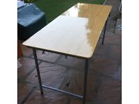 Fold up table suitable for car boot, home decorating.