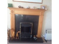 Pine Fire surround with marble hearth and backing and coal effect fan heater.