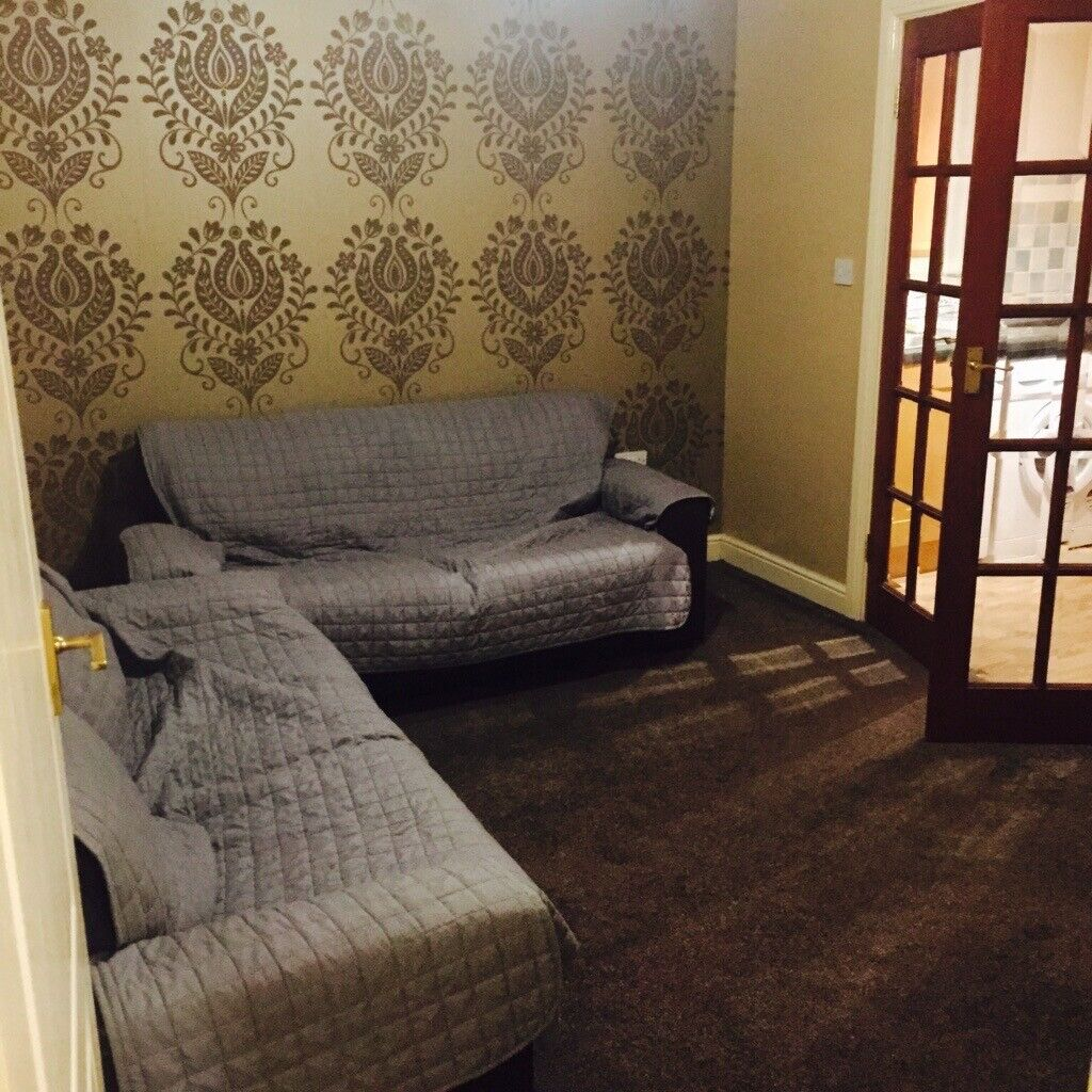 Leather Sofas 2 X Seaters In Brown With Grey Throws Over Them Can Be Used As Sofa Beds Bradford West Yorkshire Gumtree