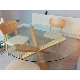 Bentley Design Four Seater Glass Top Dining Table with Four Dining Chairs