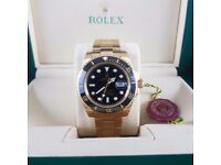 Gold Rolex Submariner with blue bezel blue face comes rolex bagged and boxed with paperwork