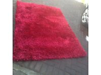 Next red shag pile rug 140cm. X 200cm. Good condition. £25.