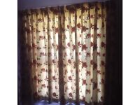 Lovely raised stitch floral and cream curtains.