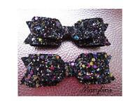 Two chunky glitter handmade bow hair clips.