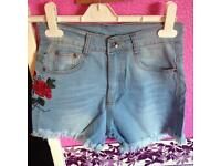 High waisted jean shorts.