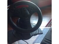 Play station steering wheel and pedals