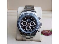 Silver Rolex Daytona Black Bezel and black face, Comes Rolex Bagged and Boxed with paperwork
