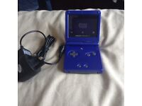 LOOK GAMEBOY ADVANCE SP WITH BRAND NEW CHARGER AND 2 GAMES