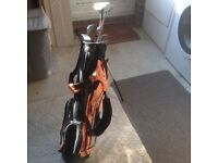 Set of junior golf clubs and bag