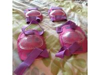Girls pink knee and elbow pads, good condition from pet and smoke free home