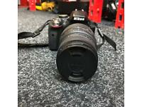 NIKON D3300 CAMERA WITH SIGMA 70-300MM LENS SPARE BATTERY AND REFERENCE MANUAL