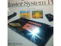 master sytem 1 boxed with two games