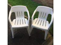 2 x white plastic chairs for sale