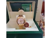New Boxed white dial gold bracelet and casing Rolex Daytona Comes Rolex Bagged and Boxed With paper