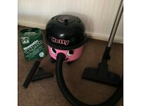 Hetty Hoover Pink. Used but in good condition. Includes attachments and spare hoover bags.