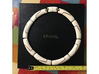 Monet costume necklace in cream lacquer and yellow metal, 13cm internal diamenter