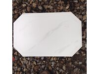 White tiles with a swirl design on them unused just been sitting in garage time to go