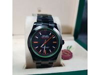 Rolex Milgauss. All Black with Green Inner Bezel. Rolex Box and Paperwork Included