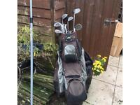 Electric golf trolley , clubs and bag