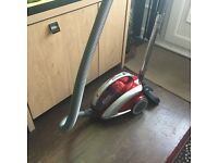 Hoover curve pull along vacuum cleaner