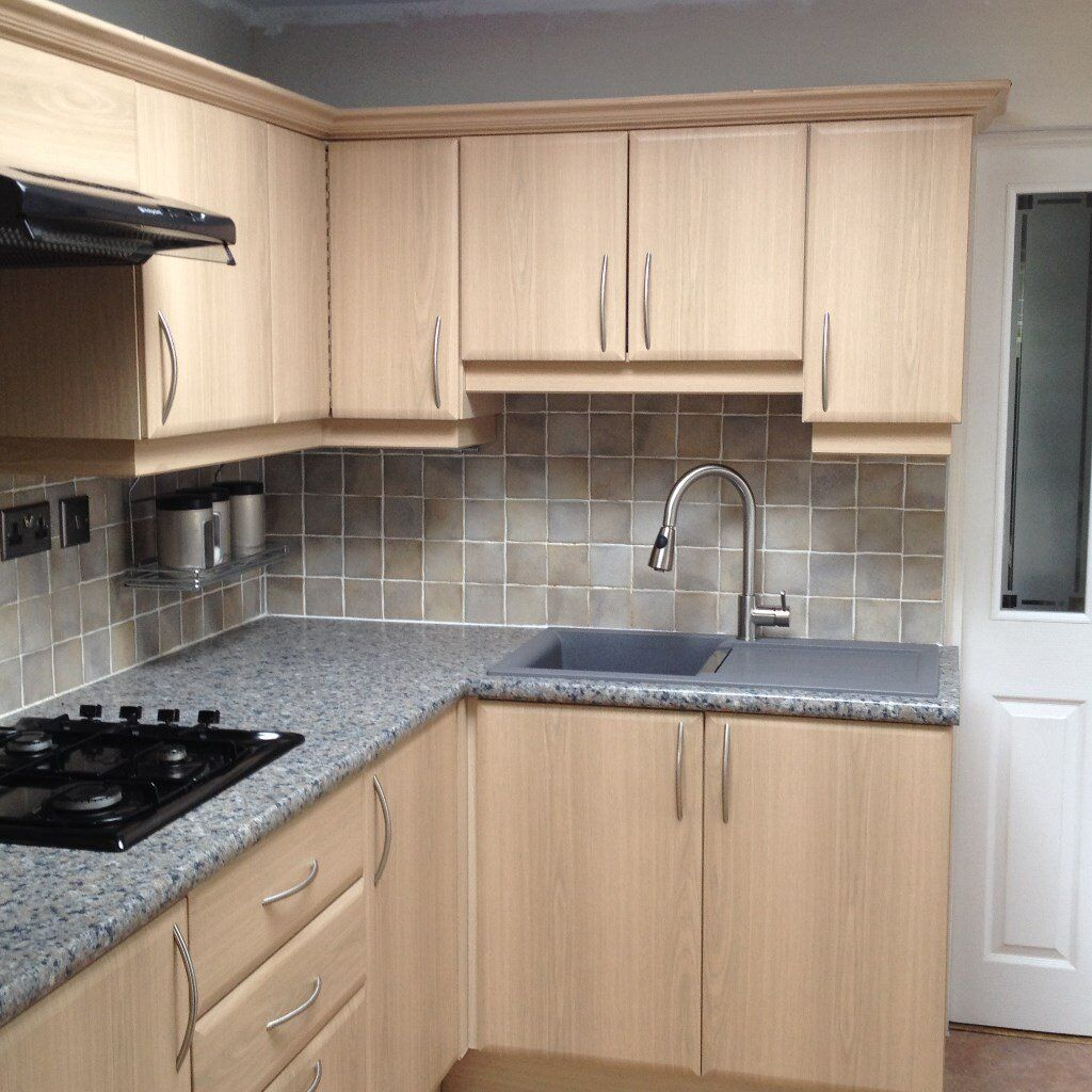 For sale complete beech coloured 14 unit solid carcass cabinet kitchen suite excluding white goods