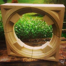 Stone bullseye window