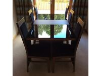Dining table and six high back chairs very good condition,selling as to big for room,1800-950