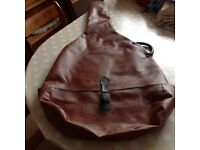 Brown pvc soft case for an acoustic guitar