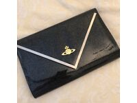 Like new. Will post. Black Vivienne Westwood clutch bag