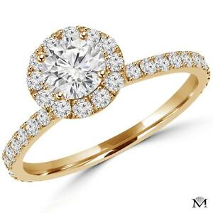 DIAMOND ENGAGEMENT RING WITH A .50 CARAT CENTER / BAGUE DE FIANCAILLE AVEC DIAMANT DE .50 CARAT
