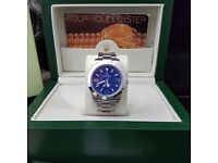 Blue faced Rolex Explorer with silver casing and all silver oyster bracelet complete with Rolex box