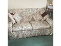 Double bed settee with loose covers.