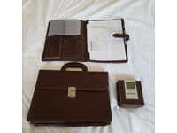 breifcase, brown leather look with acrudiments