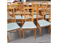Soild oak chairs with green leather seating