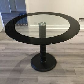 Contemporary round glass dining table