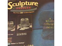 THE BEATLES SCULPTURE PUZZLE. Builds into a 3D sculpture of the four Beatles heads.