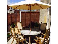 Solid oak garden table, 4 chairs & parasol.