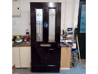 composite front door double glazed panels also one other timber exterior door with bevelled panes