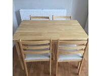Table + 4 chairs - great condition