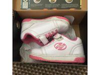 White and pink heelys