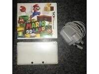 White 3DS with charger and Super mario 3D land
