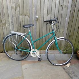 Light weight ladies bike, 5 speed, gel seat, mudguards rear carrier and high pressure tyres.