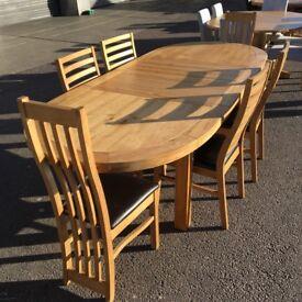 OVAL EXTENDING OAK TABLE