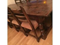 Antique oak table with slated chairs