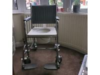 Commode, disability portable toilet. Wheelchair commode with footrests for sale