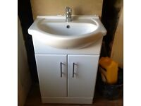 Basin and vanity unit with tap