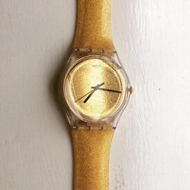 Gold and glitter Swatch watch