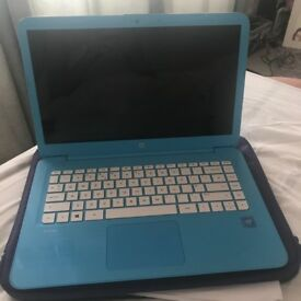 Blue HP Actel Laptop. HD screen, been used once. Brillant condition for first time Laptop users!