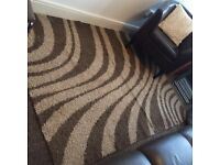 Large brown and cream shaggy pile rug