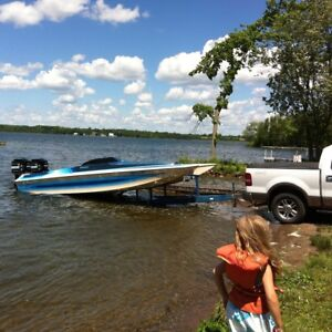Twin 200 mercury outboard tunnel hull forsale